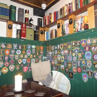 Library room at Brazen Head with Police and Fire Patches