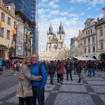 Mom and Dad in Old Town Square and Astronomical Tower